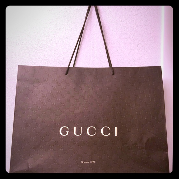 a2f360edc9a Gucci Accessories - Gucci paper bag 